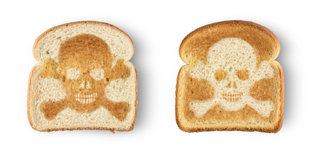77450449 – burnt toast with image of skull and crossbones. isolated on white